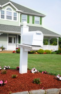 Adding fresh flowers and mulch make this mailbox very appealing.  Also the box and the post match the trim of the house, lending to a uniform look.