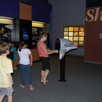 A guest enjoying one of the many interactive exhibits