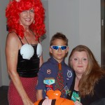 "REALTORS® Nancy Marchman (left) and Jenni ""JenniMac"" McFarland spend time with a boy scout who came to the event"