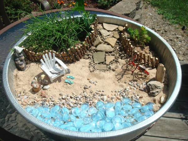 Sure there are hundreds of Fairy Gardens on Pinterest - but this one caught our eye because hello beach theme!