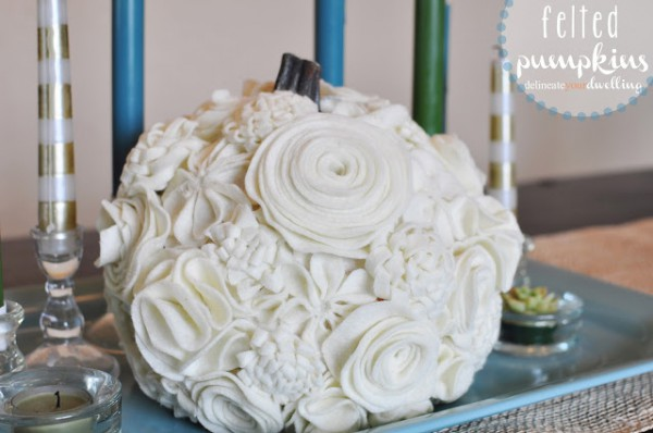 A felt flowered pumpkin might not be the traditional route but it sure does class up the traditional pumpkin.