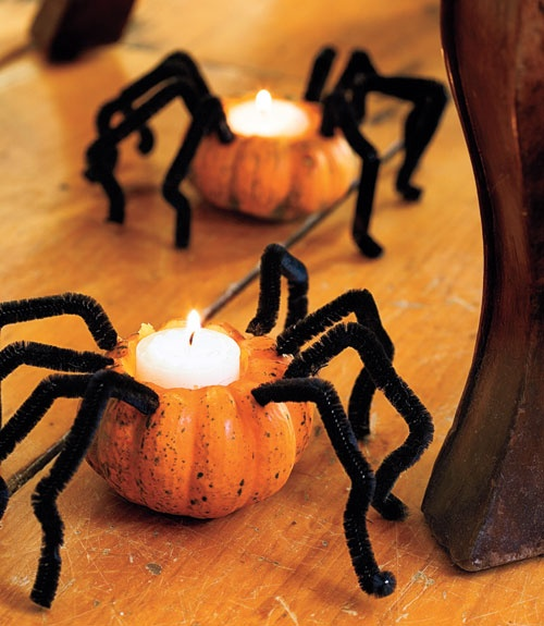 What a cute idea! Take small or mini pumpkins, add pipe cleaners for legs and then scoop out room for a tealight candle. #Halloween #DIY