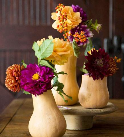 Unexpectedly lovely - these gourd vases are a lovely touch to the Thanksgiving table.