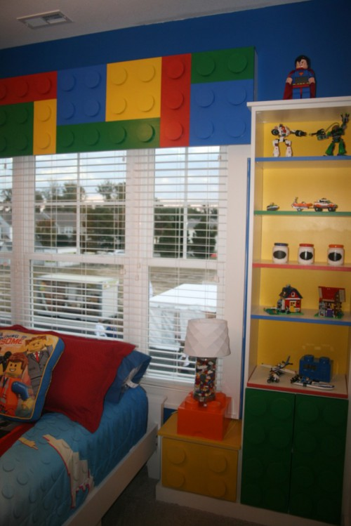What creative kid wouldn't love this fun filled room? Legos everywhere, and yes everything about it is awesome.