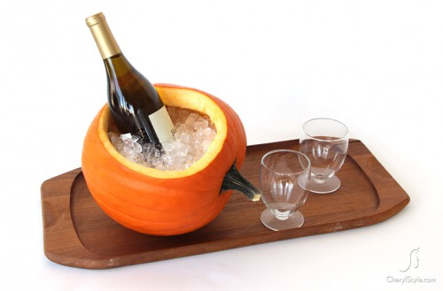 Probably the most inexpensive ice bucket - using a hallowed out pumpkin for an ice bucket. Photo and idea courtesy of CherylStyle.com