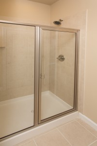 Wonderful walk in shower with low maintenance finishes in the bathroom.