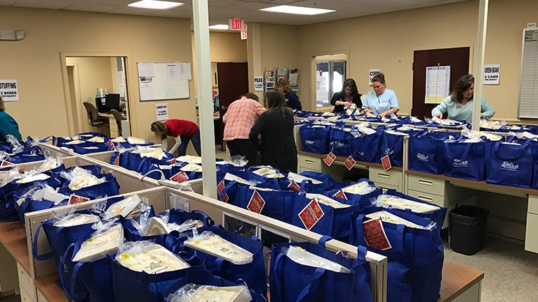 The Turkey Basket Brigade feeds 1,350 Families